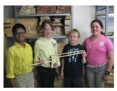 Four students with completed projects